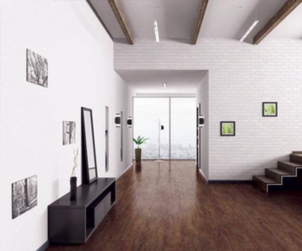 Decorative compact flexible vinyl floorcovering, with glass fibre reinforcement