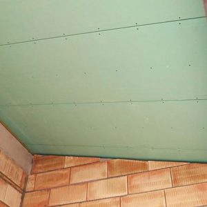 UNIPUR PLUS PB is a self supporting roof panel with 13mm water resistant tapered edge plasterboard, glued and screwed to two timber rafters.